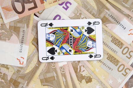 Fifty Euro banknotes and a queen of spades playing card Stock Photo - 3193258