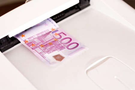 Five hundred Euro banknote in a machine