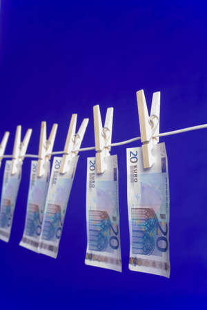 Banknotes hanging on a clothesline Stock Photo - 3193281