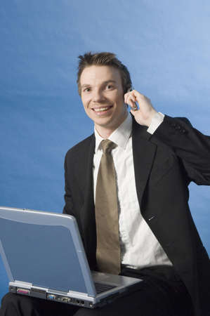 Businessman working on his laptop while talking on the mobile Stock Photo - 3193309