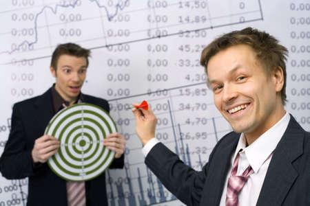 expertise: Playful businessmen playing darts LANG_EVOIMAGES