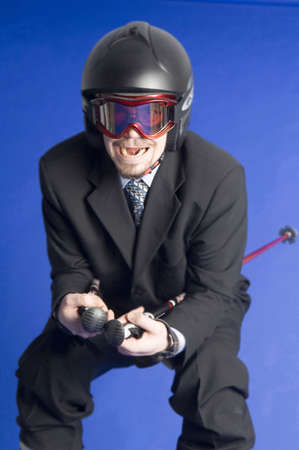 Playful businessman posing with ski gears Stock Photo - 3193335