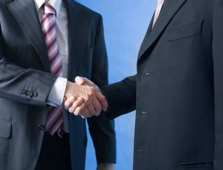 Close up of handshake by businessmen Stock Photo - 3193339