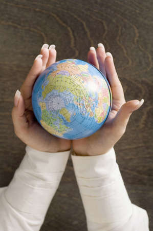 Hands holding a globe Stock Photo - 3193340