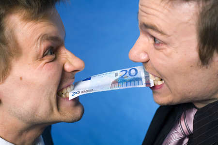 Two businessmen biting on a banknote with angry facial expressions