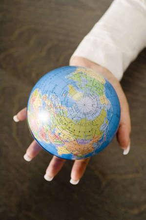 Hand with globe Stock Photo - 3193347