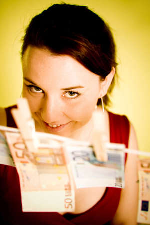 Woman posing with banknotes hanging on a clothes line Stock Photo - 3193349