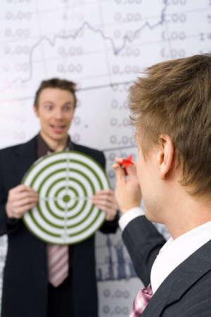 Playful businessmen playing darts Stock Photo - 3193353
