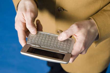 Closeup of businessman text messaging Stock Photo - 3193357