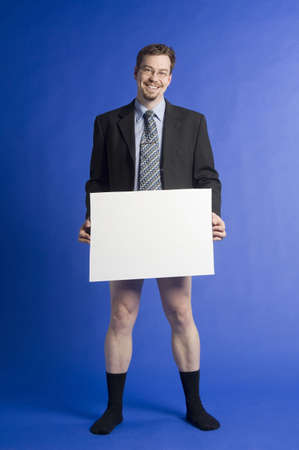 censor: Businessman posing without pants holding a censor sheet LANG_EVOIMAGES