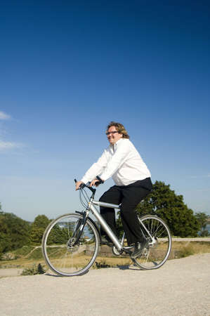 Businessman riding bicycle Stock Photo - 3193371
