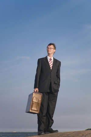 Businessman carrying a briefcase Stock Photo - 3193376