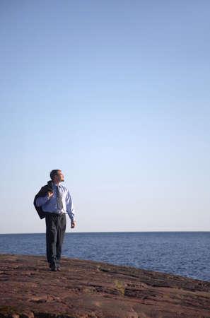 Businessman walking and enjoying the sunlight Stock Photo - 3193377