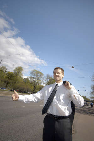 Businessman hitchhiking Stock Photo - 3193378