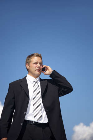 Businessman talking on the mobile phone outdoors Stock Photo - 3193380