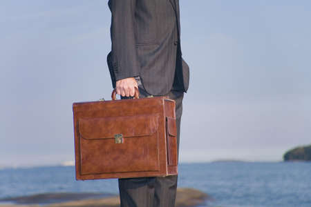 Close-up on businessman carrying a briefcase Stock Photo - 3193392