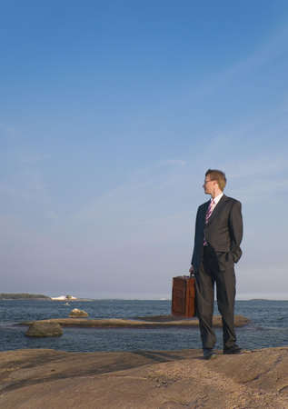 Businessman with one hand in pocket while the other carrying briefcase Stock Photo - 3193400