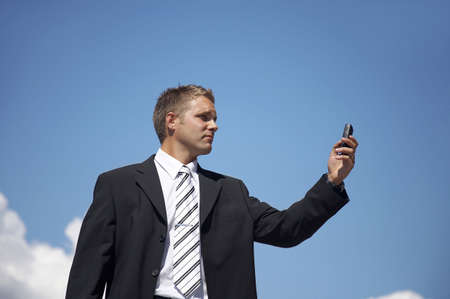 Businessman taking picture with his mobile phone Stock Photo - 3193409
