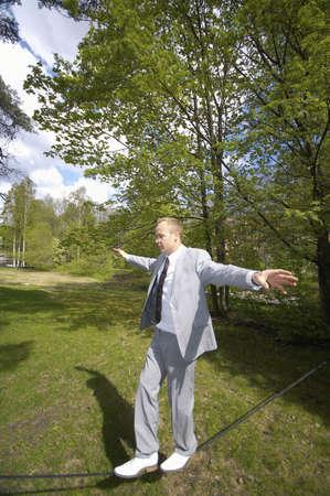 Businessman on tightrope Stock Photo - 3193410