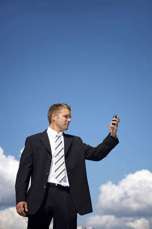 Businessman taking picture with his mobile phone Stock Photo - 3193426