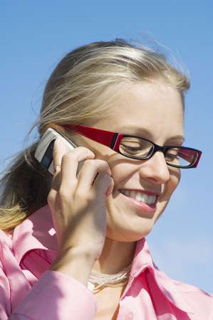 Businesswoman smiling while talking on the phone Stock Photo - 3193428