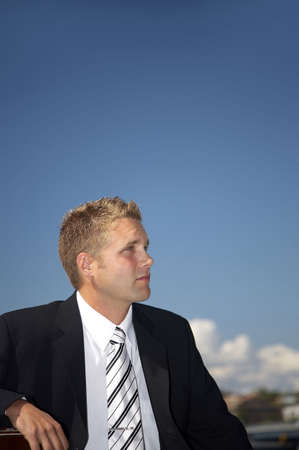 Businessman sitting outdoors, looking away Stock Photo - 3193429