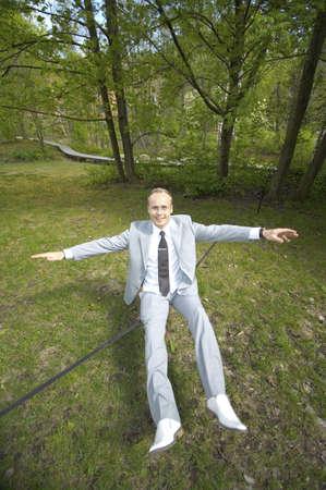 Businessman sitting on tightrope Stock Photo - 3193434