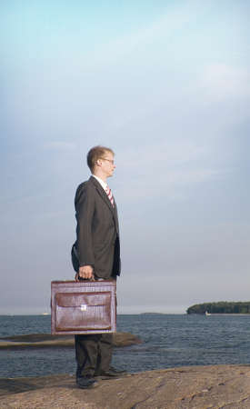Businessman carrying briefcase while looking away Stock Photo - 3193439