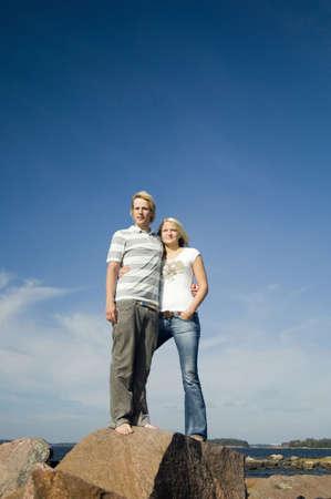 Couple standing on the rock enjoying the seaview Stock Photo - 3193447