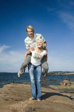 Woman carrying boyfriend on her back Stock Photo - 3193448