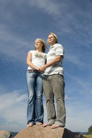 Couple holding hands while looking into the distance Stock Photo - 3193460