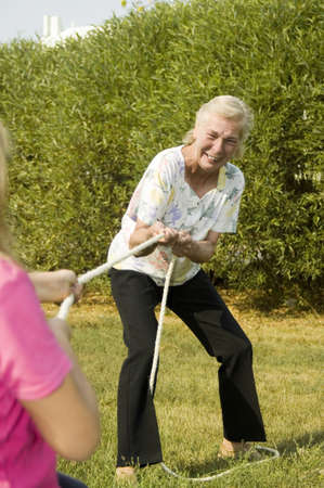 Grandmother and granddaughter playing tug of war Stock Photo - 3193478