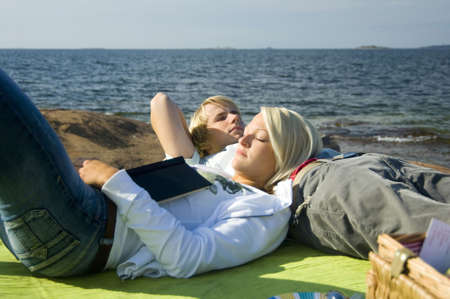 Couple relaxing by the seaside Stock Photo - 3193488