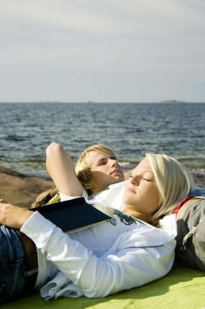 Couple relaxing by the seaside Stock Photo - 3193490