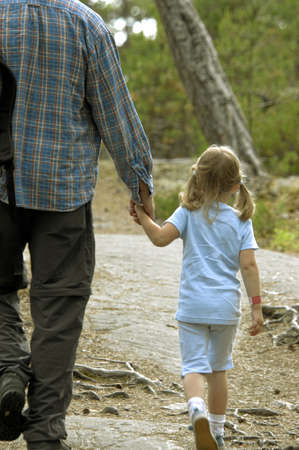 Father strolling with his daughter, rear view Stock Photo - 3193492