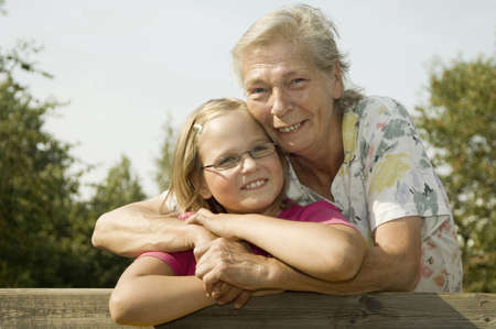 Grandmother and granddaughter hugging Stock Photo - 3193508