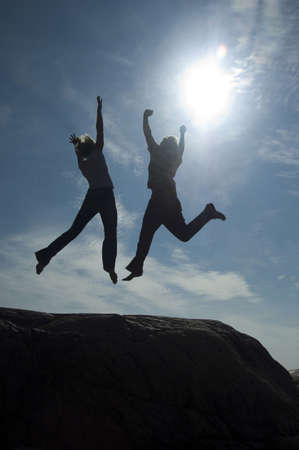 Couple jumping up in joy Stock Photo - 3193510