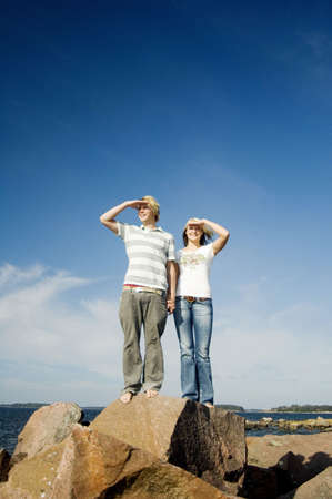 Couple shielding their eyes while looking into the distance Stock Photo - 3193512