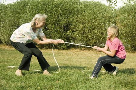 Grandmother and granddaughter playing tug of war Stock Photo - 3193514