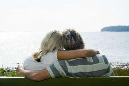 Couple sitting on the bench enjoying the seaview Stock Photo - 3193516