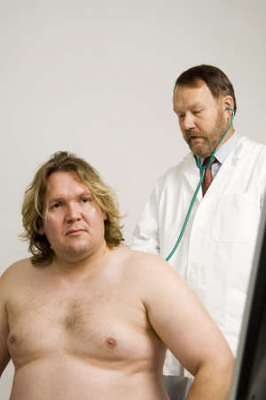 Doctor giving patient a body check up Stock Photo - 3193520