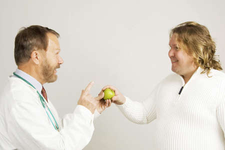 Doctor giving patient a green apple Stock Photo - 3193530