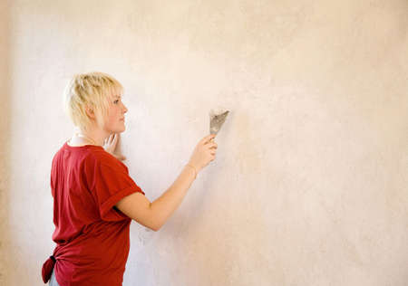 Woman scrapping the wall Stock Photo - 3193545