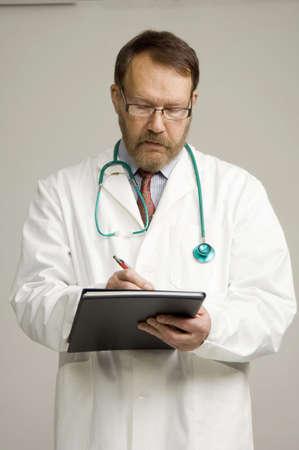 Doctor writing a prescription Stock Photo - 3193549