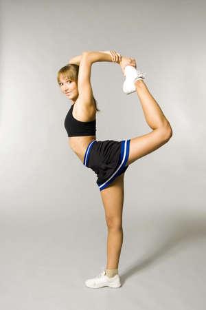 cheerleading: Teenage girl lifting up one leg