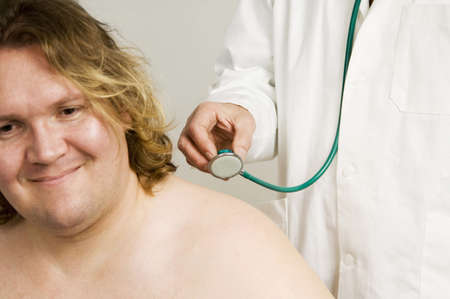 Doctor giving patient a body check up, midsection Stock Photo - 3193560