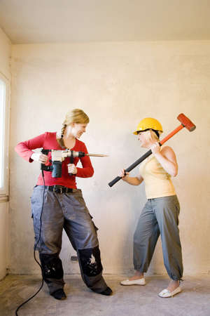 Women with sledge hammer and drill Stock Photo - 3193566