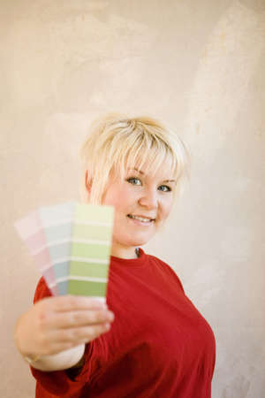 Woman showing colour swatches Stock Photo - 3193571