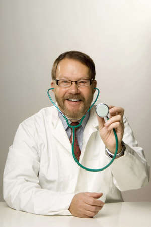 Doctor holding a stethoscope Stock Photo - 3193576