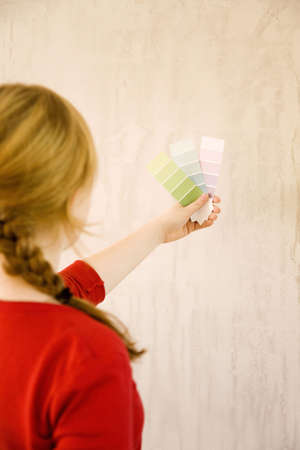 Woman choosing colour swatches Stock Photo - 3193582